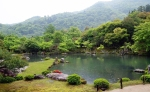 Arashiyama in the background. Koi pond in the foreground.
