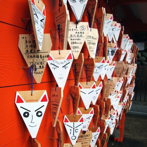 fox ema wooden prayer board fushimi inari - kyoto japan